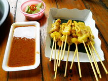 Pork satay in wood stick with peanut sauce Royalty Free Stock Photos