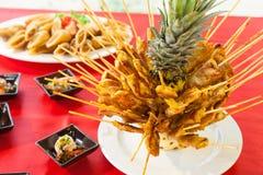 Pork satays on pineapple new food style.  Royalty Free Stock Images