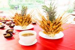Pork satays on pineapple new food style.  Royalty Free Stock Photography
