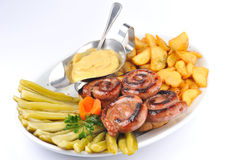 Pork sausage with fries  Royalty Free Stock Image