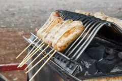 Sausage on the grill. Pork sausage on the grill royalty free stock images