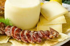 Pork sausage and pecorino Royalty Free Stock Image
