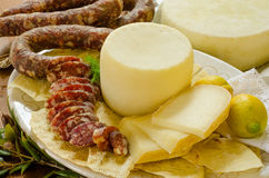Pork sausage and pecorino Royalty Free Stock Photos