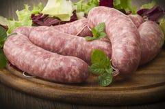 Pork sausage rolled up Stock Images