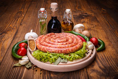 Pork sausage on wooden cutting board Stock Photos