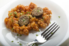 Pork sausages with baked beans Stock Photography