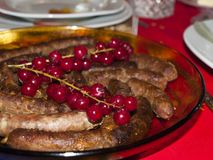 Pork sausages on the Christmas table Royalty Free Stock Photography