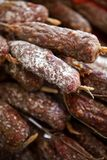 Pork sausages on a market stall royalty free stock images