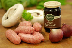 Pork sausages with relish Stock Photo