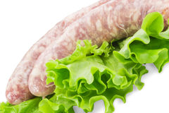 Pork sausages with salad Royalty Free Stock Images
