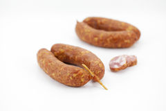 Pork sausages with a skewer from Slovenia, isolate. D on white background Royalty Free Stock Image