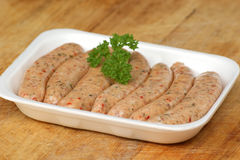 Pork sausages in a styrofoam container Stock Images