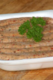 Pork sausages in a styrofoam container Stock Photos