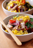 Pork and scrambled eggs in the bowl Royalty Free Stock Image