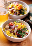 Pork and scrambled eggs in the bowl Royalty Free Stock Photos