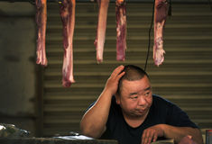 Pork seller in China facing rising price Royalty Free Stock Photos