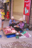 Pork seller woman Stock Photo