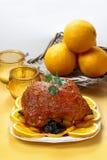 Pork served on oranges. Stock Images