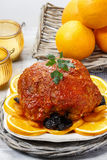 Pork served on oranges. Royalty Free Stock Photo