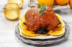 Pork served on oranges and plums Royalty Free Stock Photography