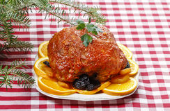 Pork served on oranges and plums Stock Photos