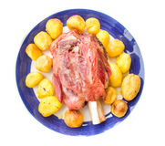 Pork shank isolated white meat bone baked potatoes raw Royalty Free Stock Photography