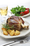 Pork shank with roasted potatoes, italian cuisine Royalty Free Stock Photography