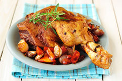 Pork Shank Roasted with Vegetables, selective focus Stock Image