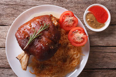 Pork shank, sauerkraut and sauce closeup. horizontal top view Stock Images