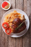 Pork shank, sauerkraut and sauce. vertical top view Royalty Free Stock Photography