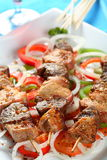Pork shashlik. With fresh tomatoes, pepper and onion slices Royalty Free Stock Images
