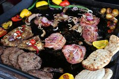 Pork and sheep steak with vegetables Royalty Free Stock Images