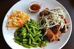 Pork shish kebab with a garnish of fresh vegetables and string bean Royalty Free Stock Photo