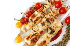 Pork shish kebab with vegetables Stock Images