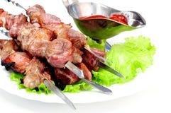 Pork shish kebab on white plate Stock Image