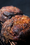 Pork Shoulder on the Smoker. A Pork shoulder that has been slow cooked all day long Royalty Free Stock Image