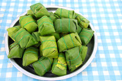 Pork, shredded and salted, bound tightly with banana leaves Royalty Free Stock Images