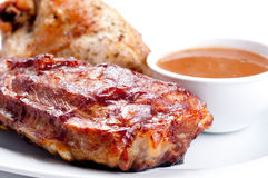 Pork side ribs. Some juicy barbequed organic pork side ribs Stock Photos