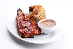 Pork side ribs. Some juicy barbequed organic pork side ribs Royalty Free Stock Photo