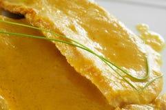 Pork sirloin with orange sauce. Closeup of a plate with some slices of pork sirloin with orange sauce Stock Photos