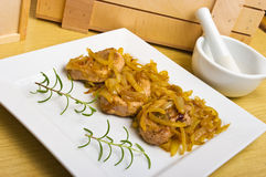 Pork sirloin steaks under onion Royalty Free Stock Photography