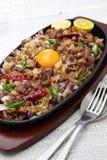 Pork sisig, filipino cuisine Stock Photos
