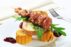 Pork skewer and baked potato Royalty Free Stock Images