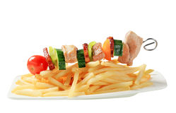 Pork skewer and French fries Royalty Free Stock Photo