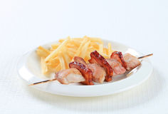 Pork skewer with French fries Royalty Free Stock Photography