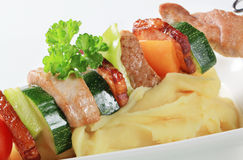 Pork skewer and mashed potato Royalty Free Stock Image