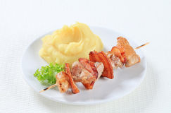 Pork skewer with mashed potato Stock Image