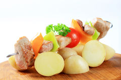 Pork skewer and potatoes Royalty Free Stock Photos