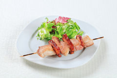 Pork skewer with salad greens Royalty Free Stock Images