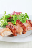 Pork skewer with salad greens Stock Images